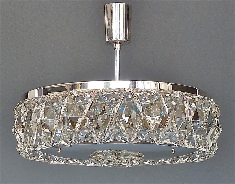 Large and early midcentury Bakalowits semi flushmount chandelier or ceiling light, Austria around 1950s. The precious chandelier is made of silver brass metal with an extraordinary faceted crystal glass ring which looks like a large sparkling