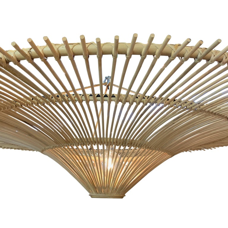 Contemporary Indonesian large round umbrella shaped chandelier made of bamboo Single bulb 60watt to 300 watt maximum Also available in two additional sizes L976A.  20.5
