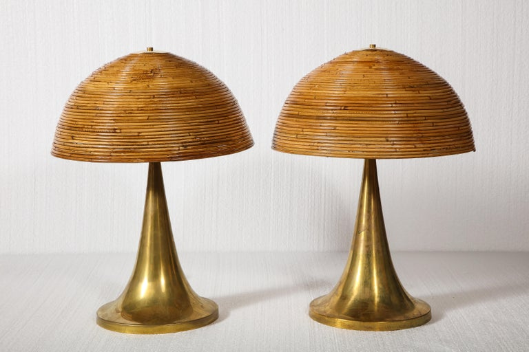 Large bamboo pair of table lamps with brass bases  Beautiful and chic table lamps. Lovely brass bases and bamboo tops held by brass top.