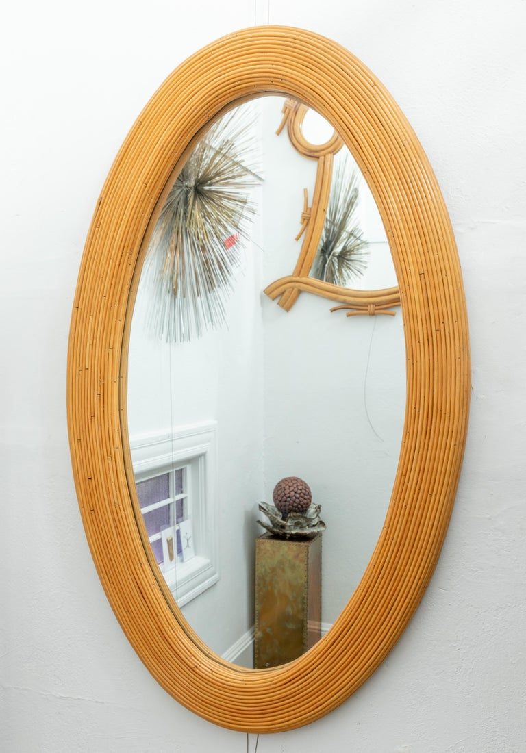 Large bamboo reed woven oval mirror.