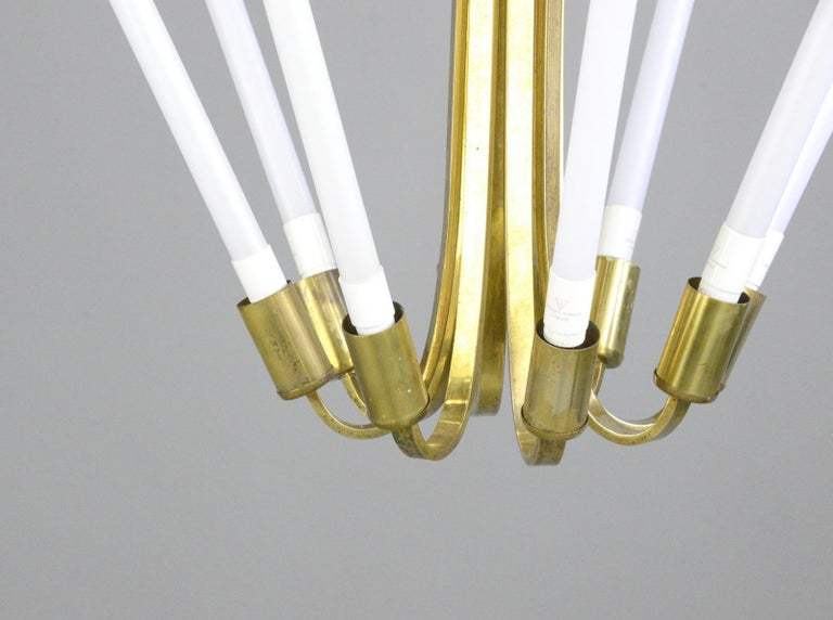 Large Bauhaus lobby chandelier, circa 1930s  - Sculptural curved brass - Takes 8x LED tube bulbs - Original designed to hang in cinema lobbies - Made by Kaiser - German, 1930s - Measures: 70cm tall x 98cm wide  Condition report:  Fully re