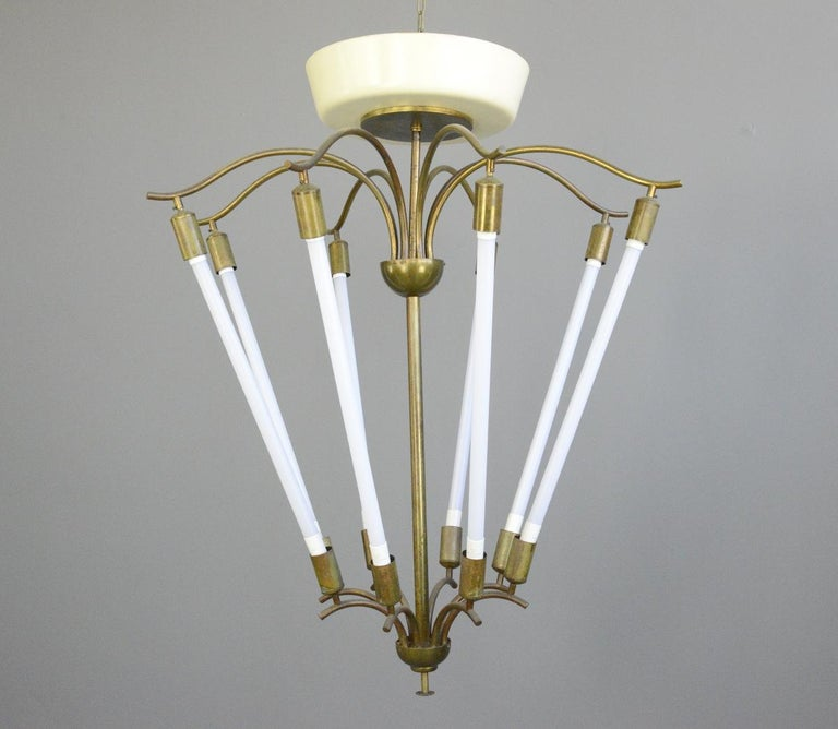 Large Bauhaus lobby chandelier, circa 1930s  - Sculptural curved brass - Takes 8x LED tube bulbs - Original designed to hang in cinema lobbies - Made by Kaiser - German, 1930s - Measures: 112cm tall x 93cm wide   Condition report:  Fully