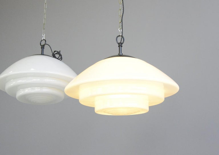 Large Bauhaus pendant lights by Mithras circa 1930s  - Price is per light (8 available) - Stepped opaline glass - Comes with 100cm of black braided cable - Comes with ceiling rose and chain - Takes E27 fitting bulbs - Produced by August