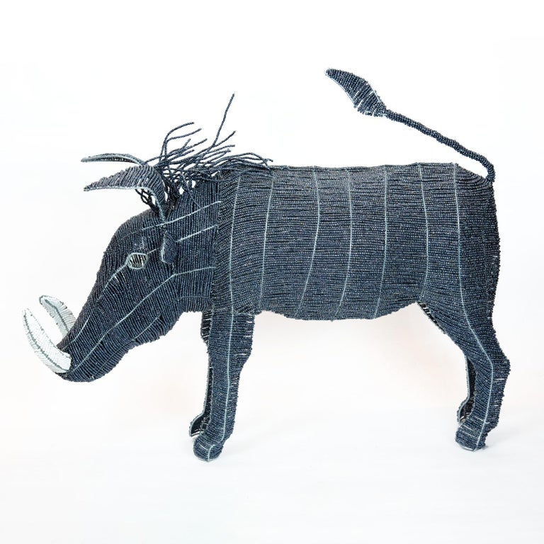 Large Beaded African Warthog. Handmade in Africa from beads and wire. Deep-blue metallic body, hair, and tail with white tusks.  36