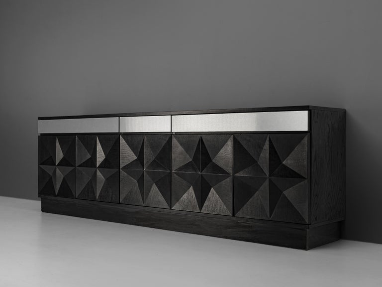 Sideboard, black lacquered oak, metal, Belgium, 1970s  This Belgian sideboard features a wonderfully designed front. The five-doored piece is equipped with three drawers on top. These are highlighted in the way that they feature sleek fronts in