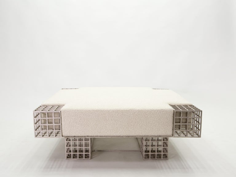 This is a very rare and unique Italian bench ottoman designed by Carla Sozzani for her gallery in Milano in the late 1990s. With strong architectural lines, the handmade steel structure is a work of art. It has been fully restored, and newly