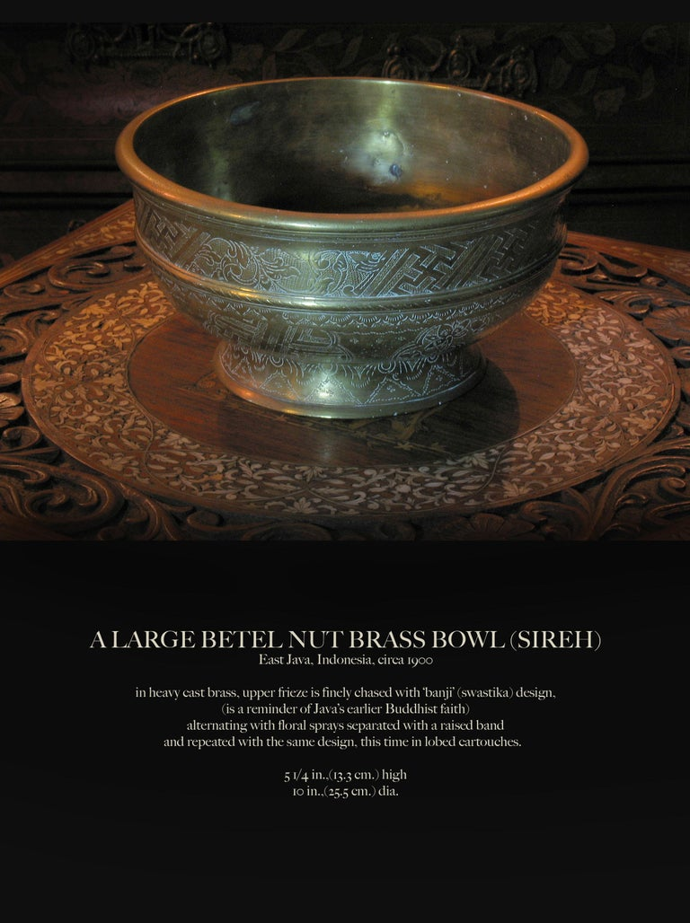 A large betel nut brass bowl (Sireh) East Java, Indonesia, circa 1900  In heavy cast brass, upper frieze is finely chased with 'banji' (swastika) design, (is a reminder of Java's earlier Buddhist faith) alternating with floral sprays separated