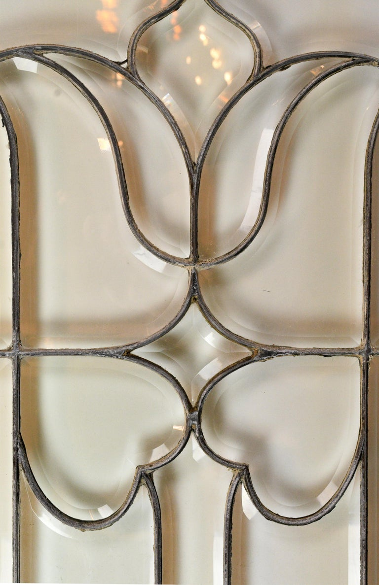 Large beveled glass window with a simple and elegant pattern throughout. Complete with wood frame,  circa 1900 Condition: Excellent Finish: Original.