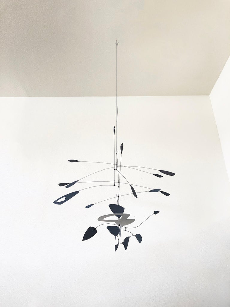 Large hanging black and white kinetic mobile sculpture by Colorado artist Robert Delaney. This is one of his early pieces. Stamped R. Delaney 2000 on the white section.  His work can be found at Kirkland Museum of Fine and Decorative Art in