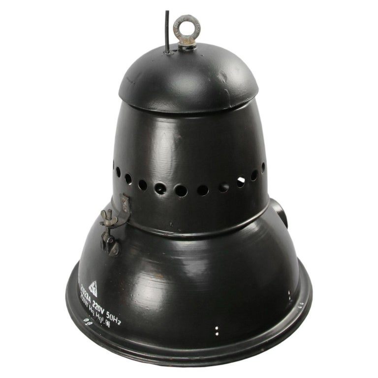 Black enamel Industrial lamp. White interior cast iron top.  Measures: Weight 7.5 kg / 16.5 lb  Priced per individual item. All lamps have been made suitable by international standards for incandescent light bulbs, energy-efficient and LED