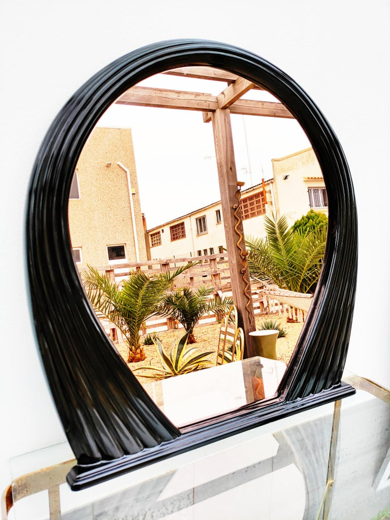 Beautiful and rare large black lacquered mirror, manufactured in France in 1970s. The mirror is slightly smoked coppery.