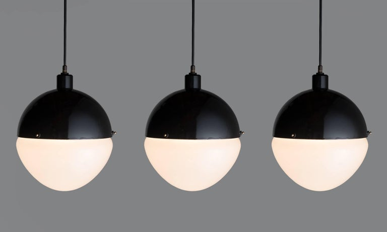 Large Black Metal and Frosted Glass Globe Pendant, Italy, 21st Century  Black enamel fitter with frosted glass shade.  Overall height adjustable.