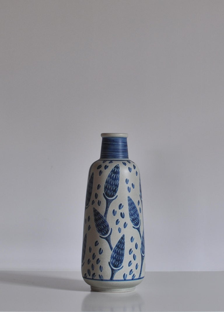 Hand painted floor vase from the 1960s by Danish artist Rigmor Nielsen at Søholm ceramics workshop, Bornholm. Each of these vases were made by hand and are unique in their decorations. This example features a beautiful corn motif in blue and white