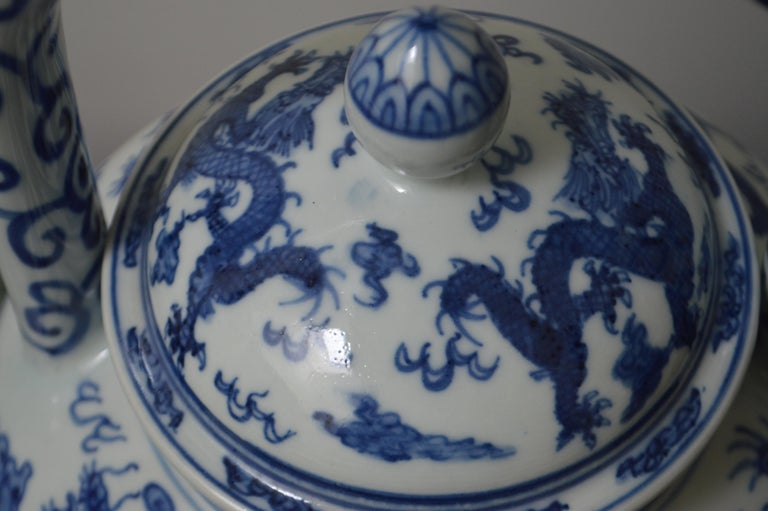 A large blue and white porcelain tea pot with large top handle, lid and dragon motif. It also has an Apocryphal Longging mark on the bottom. Excellent condition.