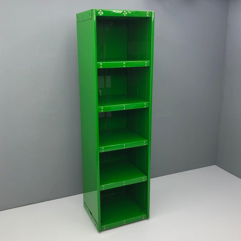 Large book case by Otto Zapf, InDesign Germany 1971:.  Green Foil. The shelves are adjustable in height.  Very good condition.