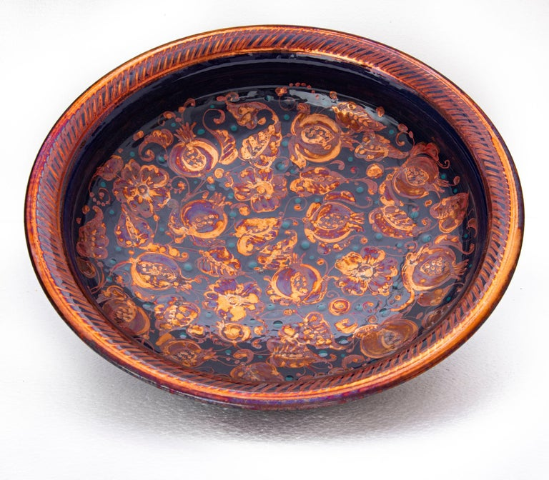 Large bowl with pomegranate decor, full-fire reduction faience earthenware 40 cm diameter, unique piece, 2020  Bottega Vignoli is a brand of artistic ceramics based in Faenza, one of the most representative ceramic production centers in Italy.