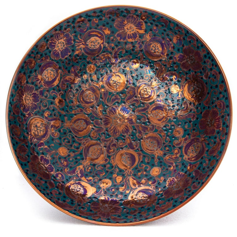 Large bowl with pomegranate decor, full-fire reduction faience earthenware 40 cm diameter, unique piece, 2020  Bottega Vignoli is a brand of artistic ceramics based in Faenza, one of the most representative ceramic production centres in Italy.
