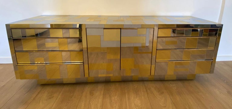 Large brass and chrome sideboard by Paul Evans from the Cityscape Collection for Directional, circa 1970's All chrome and brass tiles mosaic patchwork,  Rare design combines on: Either side flanking four set of drawers,  Pair of double door in