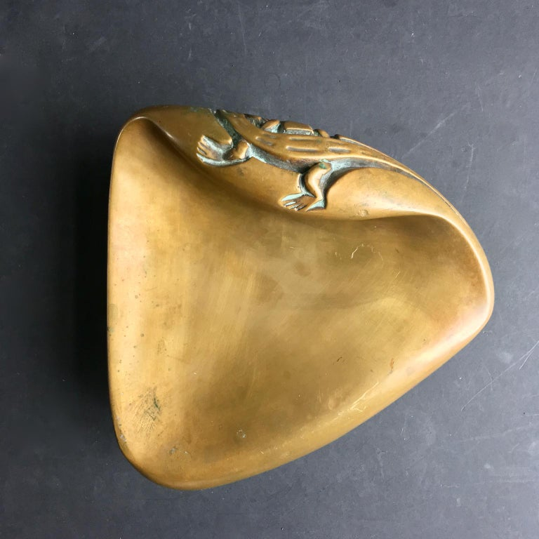 *** Special price for October ***  A large sculptural brass door handle in organic form with stylized salamander motif. Mid-20th century European. Unsigned.  A heavy piece, made of cast brass (perhaps bronze) with very nice changing tones from use;