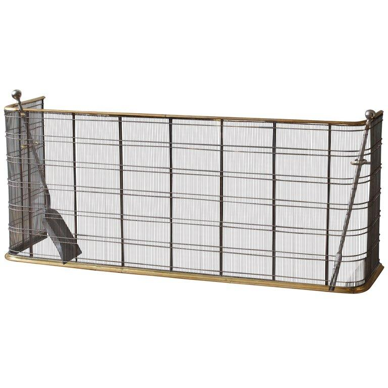 This faithful copy of an early 19th century fender, or nursery fire guard, provides ultimate protection combined with the elegance of moulded brass and finely worked mesh.