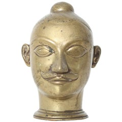 Large Brass Lingam Cover in the form of a Head, India, 18th Century