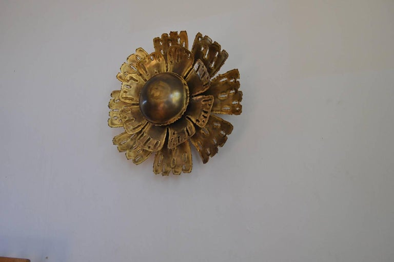 Large brass flower shaped wall lamp by Svend Aage Holm Sørensen, the 1960s in Denmark. The lamp is made of torch cut brass and the shades gives an amazing light effect. 