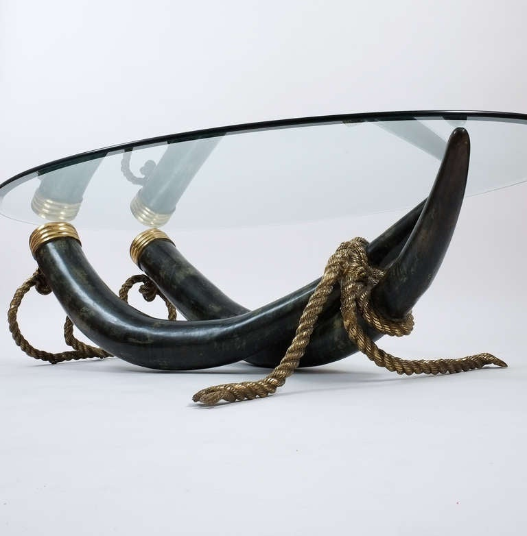Sculptural bronze base by Italo Valenti, Spain circa 1975  Elephant tusk table base made from bronze cast tusks with brassed parts. A solid bronze 'rope' is stabilizing the ensemble. The condition is good to very good. This offer is for the base