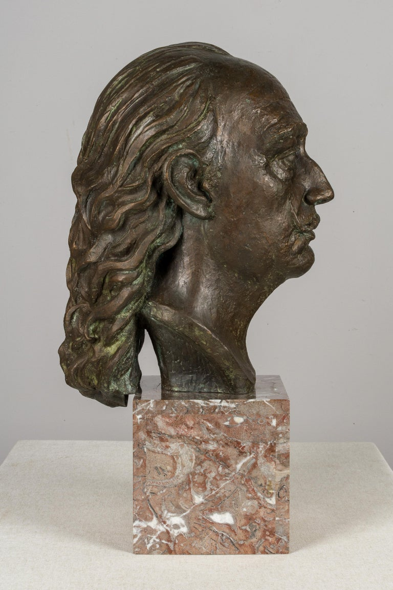 A large cast bronze bust of Surrealist artist Salvador Dali by Spanish sculptor Raimon Casals i Alsina (Barcelona 1922-), circa 1986. One of 9 copies. At present, a copy can be seen at the Abelló Museum in Mollet. On a Languedoc marble base. Total