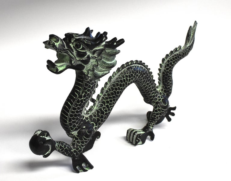 The dragon is the most important symbol in Chinese culture. A sign used by the Emperors, it represents power, leadership and prosperity. This wonderful large sculpture captures the dragon in motion. The fire ball in dragon's paw symbolizes unity and
