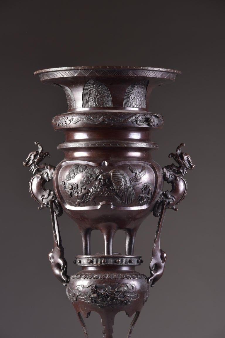 Finely decorated and very large bronze incense burner. The base with a lion on top and two vases with decorations of birds, flowers and dragons. On top is a removable bowl (diameter is 34 cm / 13 in). Total height is 84 cm without and 99 cm with