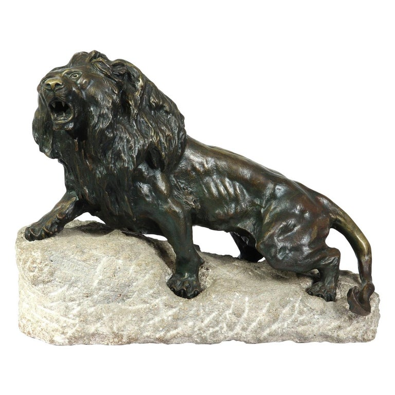 Large Bronze Lion on a Rock by Cartier, circa 1920 For Sale