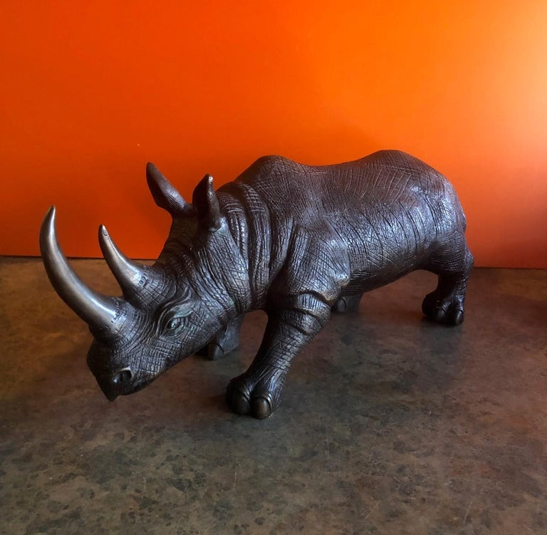 Large bronze rhinoceros / rhino sculpture, circa 1990s. The piece has great detail and patina and measures 20
