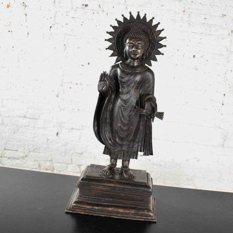 Large Bronze Tibetan Standing Buddha Sculpture with Halo Patinated In Good Condition For Sale In Topeka, KS