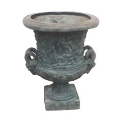 Large Bronze Urn with Rams heads handles and figural design