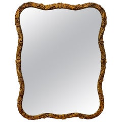 Large Carved and Curved Gold Giltwood Wall Mirror