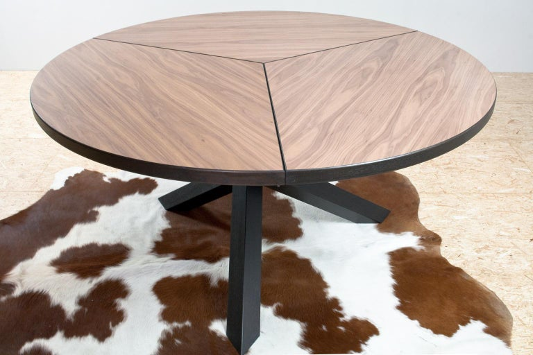 Large Brutalist round tripod dining room table for 6 to 8 people. The table is a re-make of a 1960s Dutch modernist item often referred to as a Martin Visser design. The listed item has a large walnut veneered table top and dark ebonized oak tripod