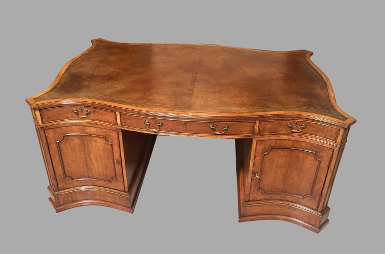English Large Burl Elm Serpentine Partners Desk with Gilt-Tooled Leather Top For Sale