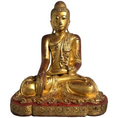 Large Burmese Mandalay Period Carved, Lacquered and Gilt Teak Buddha, circa 1900