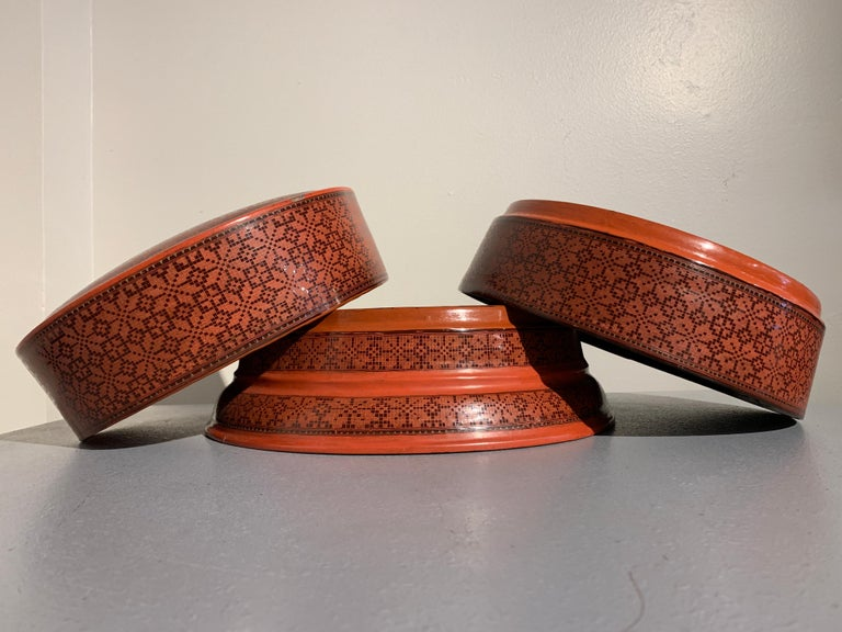 Tribal Large Burmese Red and Black Lacquer Tiered Round Box, Early to Mid-20th Century For Sale