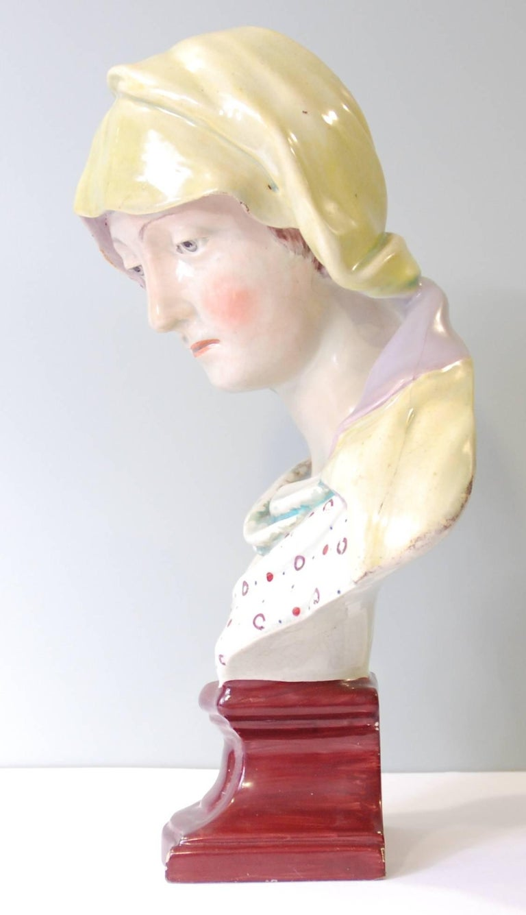 A large and impressive bust, taken from Michelangelo's Pietà. Creamware, modelled and made by Ralph Wood, with enamelling.