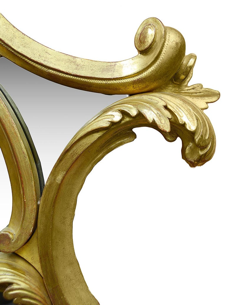 A good quality large carved giltwood wall mirror, in the Chippendale style, having scrolling foliate and shell decoration.
