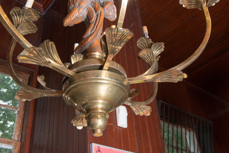 Hart & Associates brass chandelier with large central carved parrot. Six candelabra lights. Includes chain and canopy. Brass has a nice patina with a distressed finish.