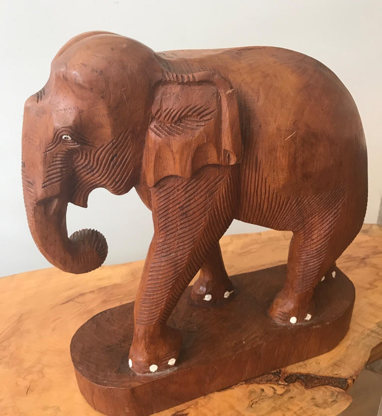 Large finely carved Indian wood sculpture of an Elephant.