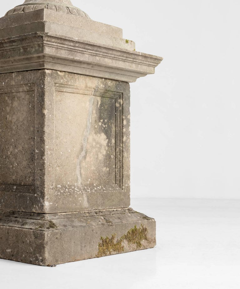 Large cast stone urn with pedestal, circa 1950.