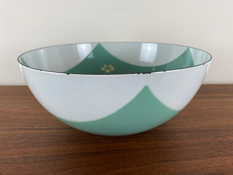 This is the largest of the Catherineholm collection flag bowls. This example is a rare seafoam green and white enamel.
