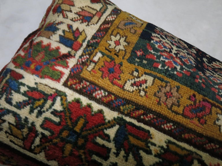 Pillow made from an antique Caucasian Shirvan rug with zipper closure included.