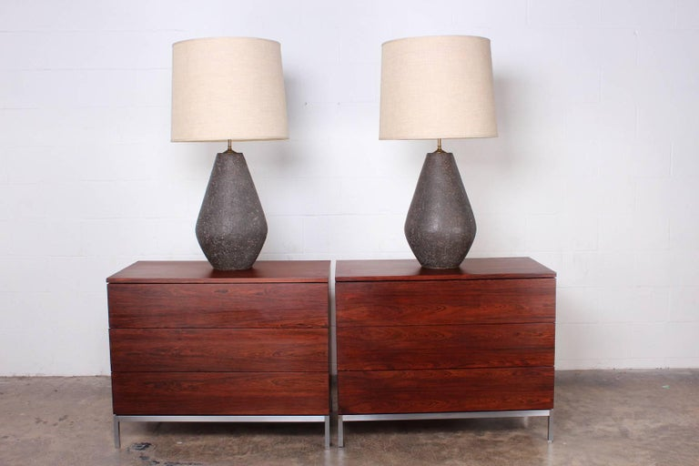 A monumental pair of handmade, slab built ceramic lamps with wonderful color and texture. Original shades included and in great condition.