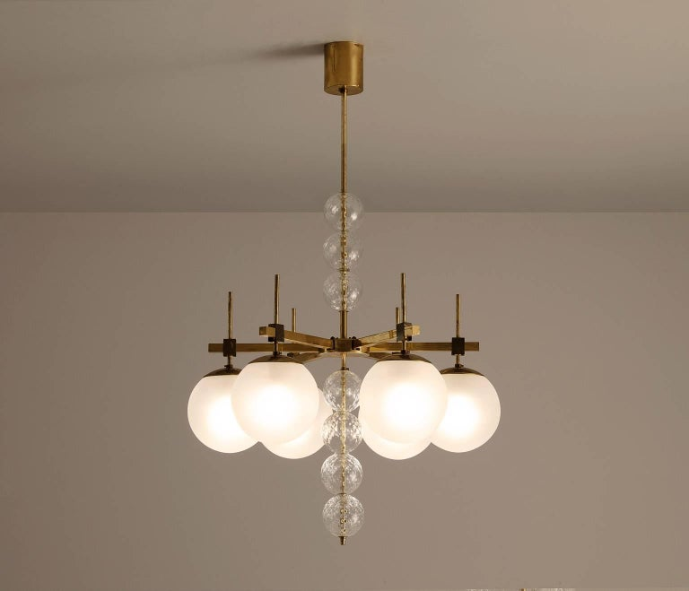Large chandelier in brass and frosted glass, Europe, 1960s.   Brass chandelier with six-light points, shades of opaline glass. The chandelier is beautifully decorated with structured glass spheres. In combination with the frosted glass, these