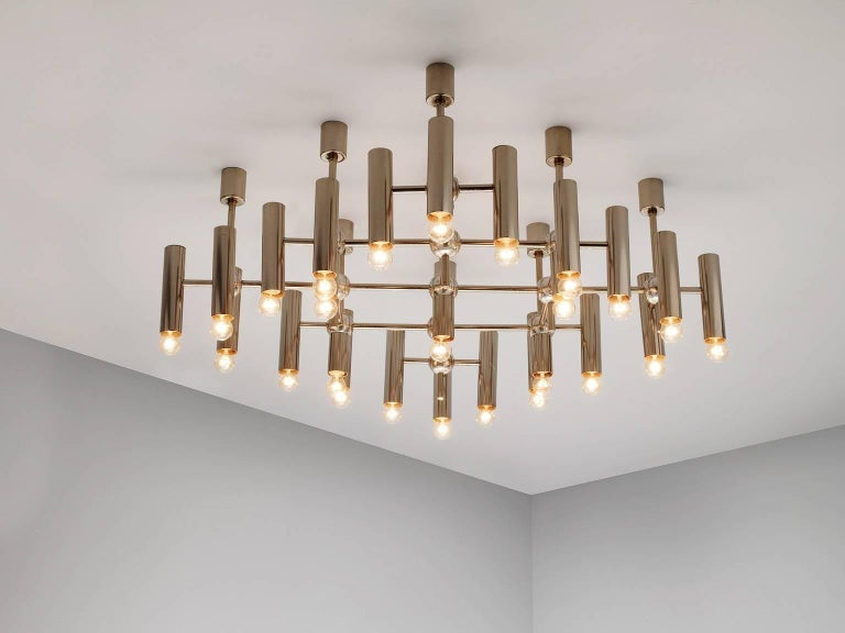 Chandelier, in nickel-plated steel, Germany 1970s.   Large set of four chandeliers in nickel-plated steel. Stunning modern design. The chandelier consists of 25 lights, arranged in a symmetrical and diagonal pattern. The large amount of lights is