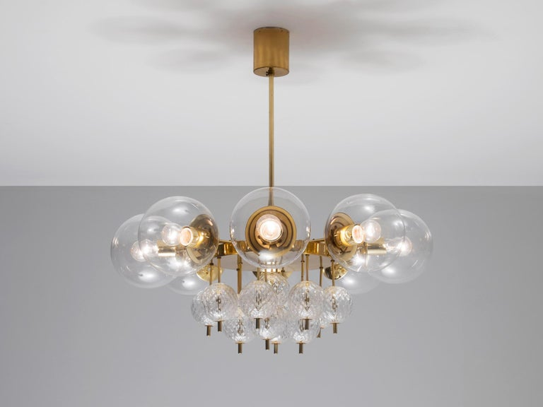 Large brass chandelier with beautiful glass bulbs, 1960s.   This lights were found in the very south of the Czech Republic, so most likely from Austrian production seen their excellent quality with which they have been manufactured. Eight large